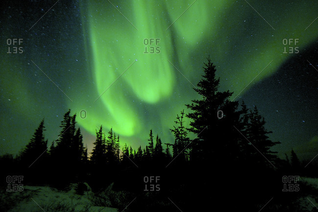The northern lights move around in the winter sky