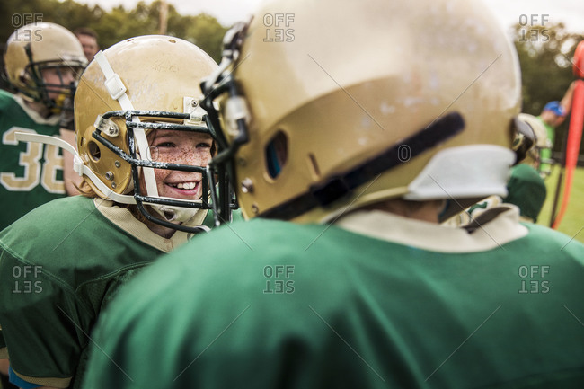 Smiling boy football player