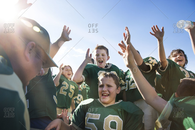 Coach gives youth football team pre-game pep talk
