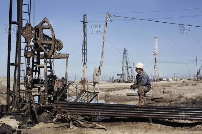 Baku, Azerbaijan - October 14, 2011: A worker in the oil field, called James Bond Field for the real location ofthe movie
