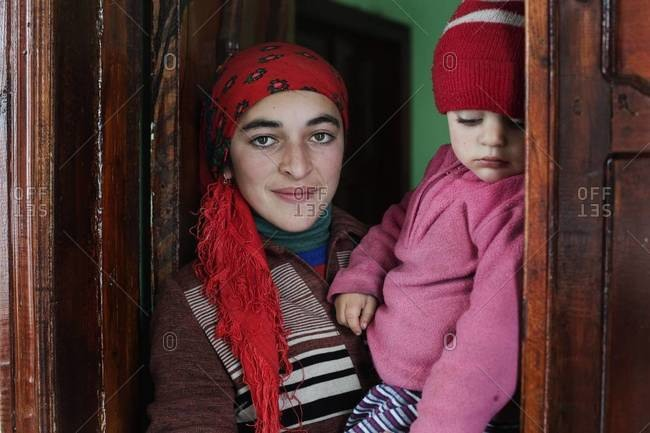 Xinaliq, Azerbaijan - October 26, 2011: Portrait of a woman with child in Xinaliq