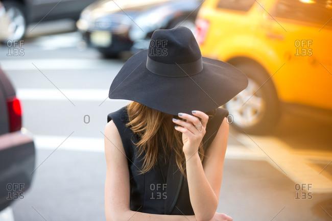 Woman wearing a wide brimmed hat