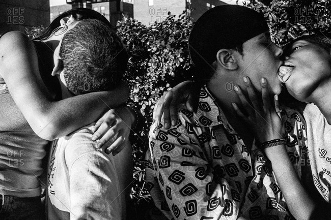 New York City - Circa - 1998 -2002: Teenagers making out in a park
