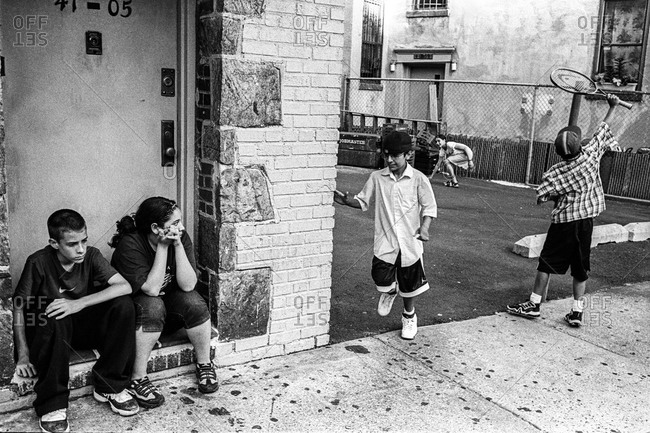 New York City - Circa - 1998 -2002: Kids hanging out in the streets of New York City, USA