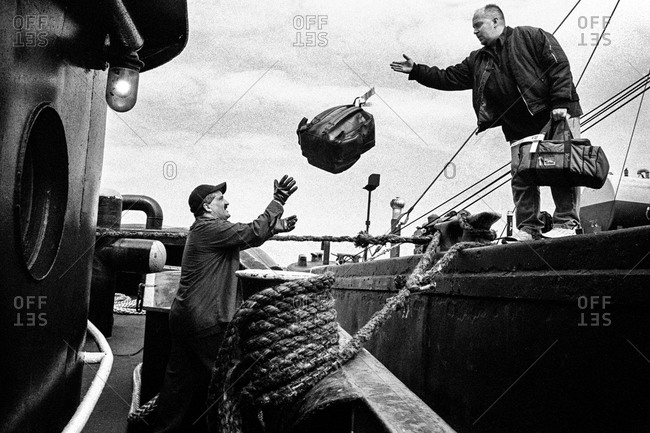 New York City Harbor - Circa - 2000: Dockworkers loading a tugboat in New York, City