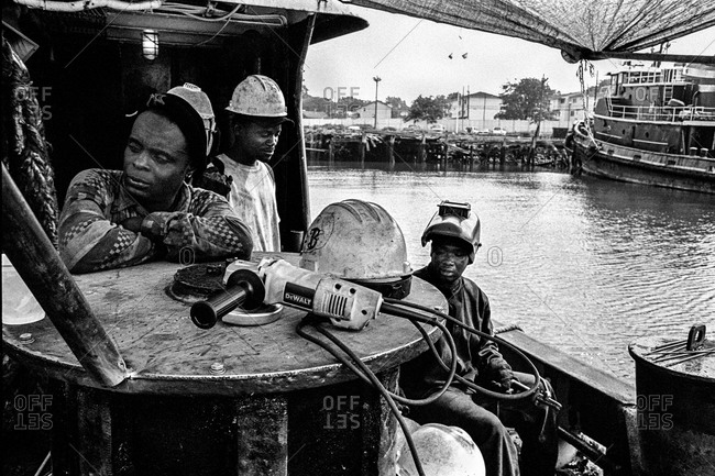 New York City Harbor - Circa - 2000: Dockworkers resting on a tugboat in New York, City