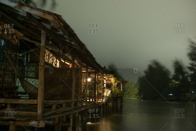 Distinctive stilt houses at night in Koh Chang district, Thailand