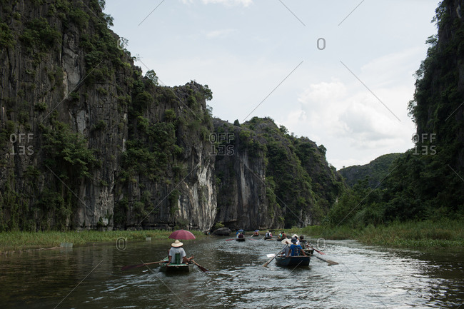 Tourists traveling by boat on a Vietnamese river