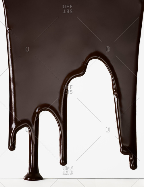 Melted chocolate trickling down a white surface