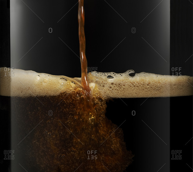 Pouring a pint of dry stout