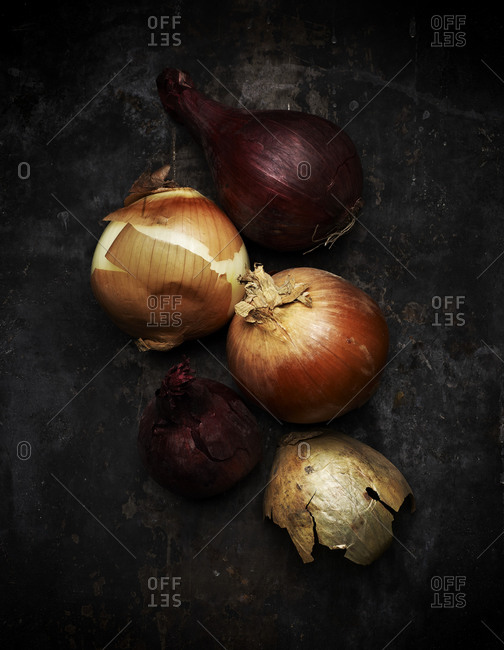 Close up of onions on black background