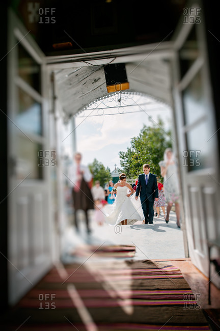 Bride and groom approach entrance of church