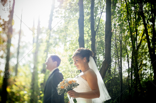 Bride and groom outside in forest