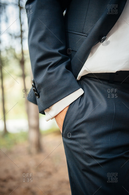 Close-up of groom's hand in pocket