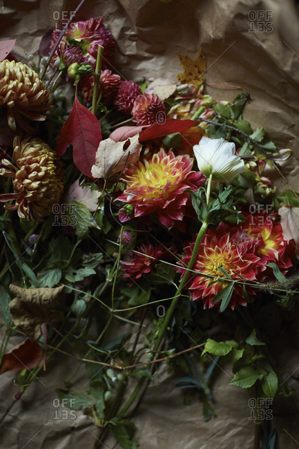 Discarded flowers and autumn leaves