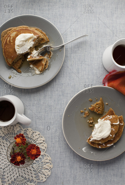 Pumpkin pancakes served with coffee on a table