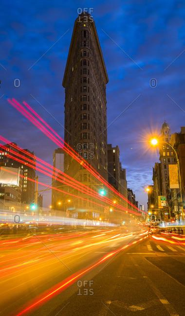 New York, NY, USA - June 20, 2014: Traffic at night, Flatiron Building in background