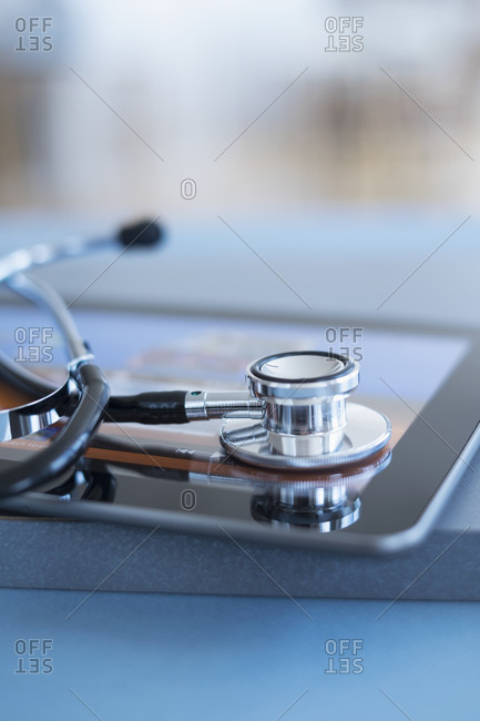 Close up view of stethoscope on digital tablet