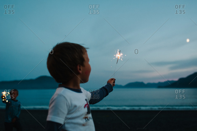 Boys playing with sparklers