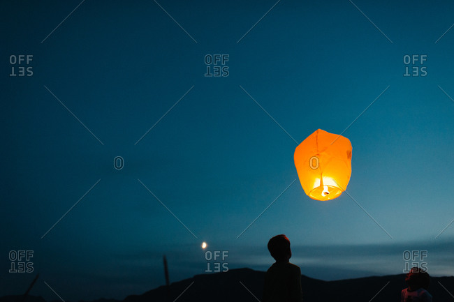 Sky lantern flying at night