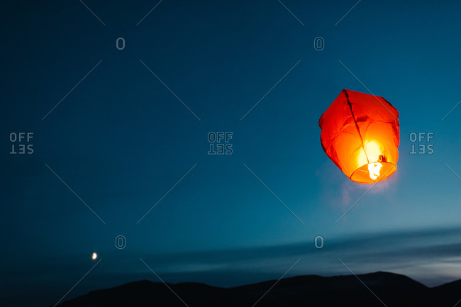 Release of a sky lantern at night