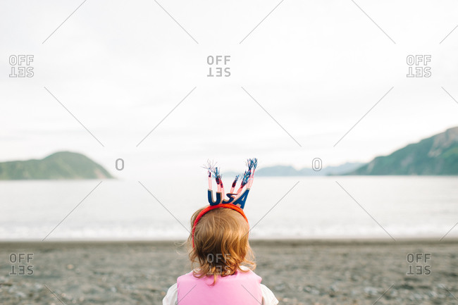 Rear view of little girl wearing patriotic headband