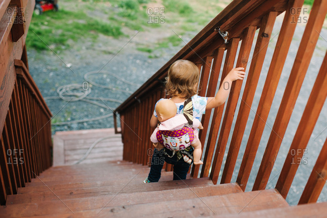 Toddler walking down outdoor steps