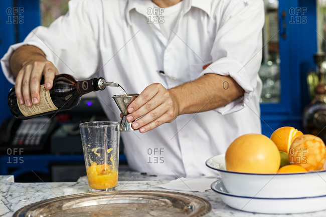 Bartender making Martinique punch cocktail