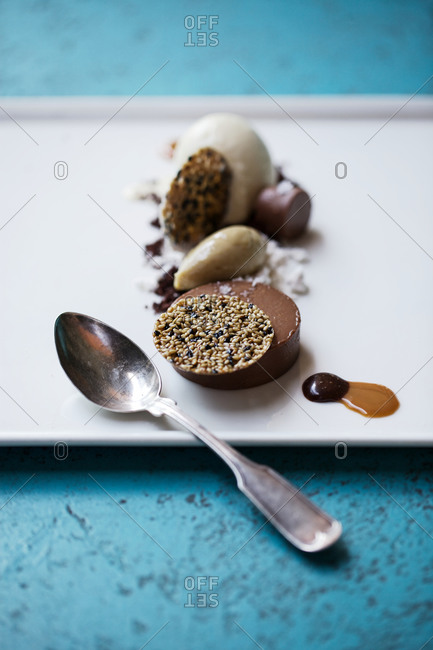 Chocolate bar served with sesame seed brittle
