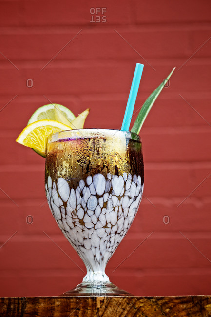 Garnished cocktail with a straw