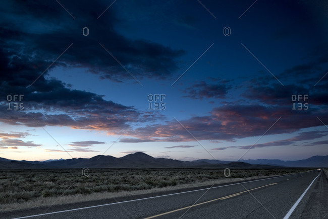 Road and mountain range in the distance
