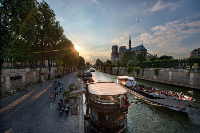 Paris, France - June 24, 2014: Tourist on boat on Seine nearby the Notre-Dame