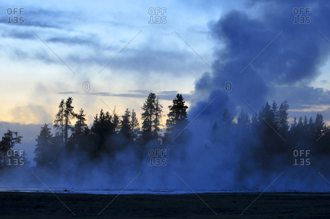 Steam rising from Lower Geyser Basin in Yellowstone National Park at sunset, Wyoming