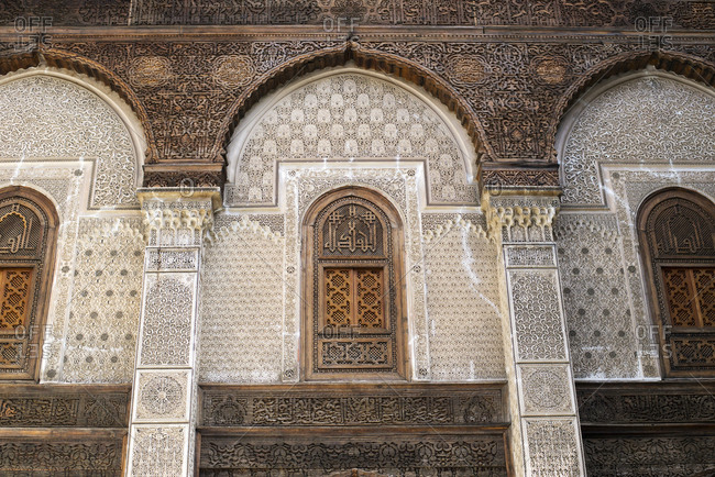 One of the many elaborate walls of the famous Madrasa Bou Inania in Fes el-Bali, Fes, Morocco