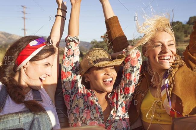 Women on a road trip enjoying the wind