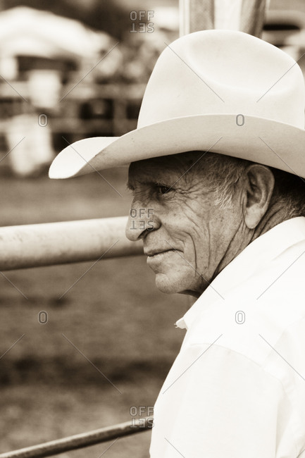 Wagon Mound, New Mexico, USA - September 7, 2009: Old cowboy watches the riders