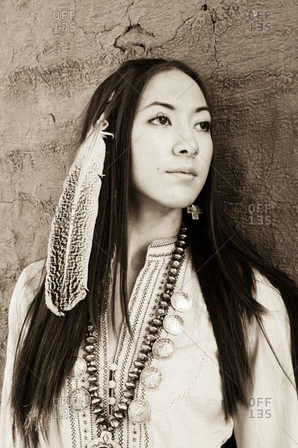 Young woman wearing Native American costume