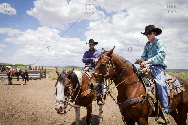 Galisteo, New Mexico, USA - July 10, 2011: Cowboys mounted on horses at a rodeo