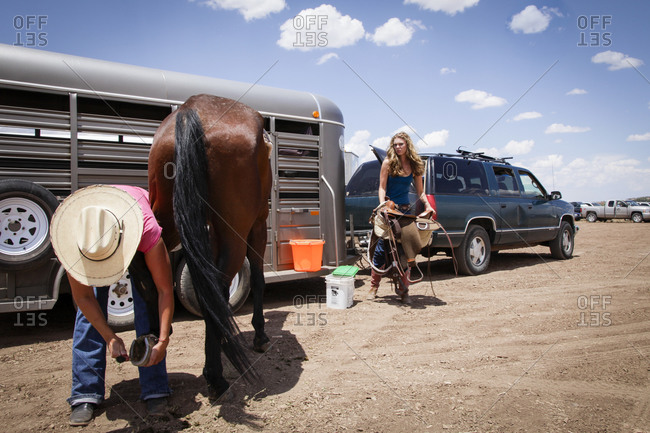 Galisteo, New Mexico, USA - June 10, 2011:People getting their horse ready