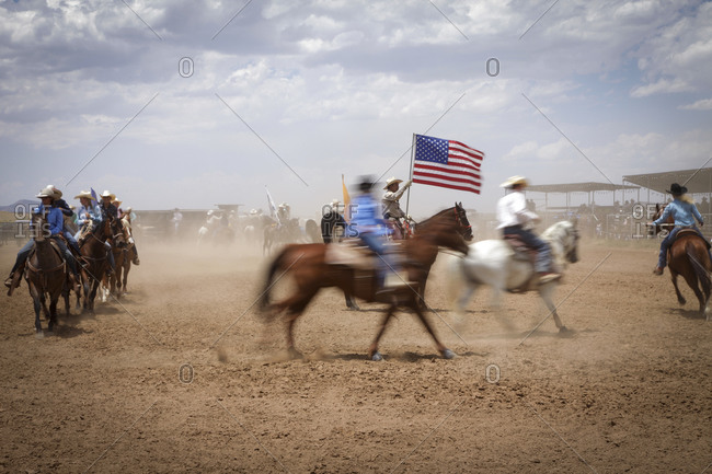 Galisteo, New Mexico, USA - July 10, 2011: Entrants of a rodeo riding in the ring
