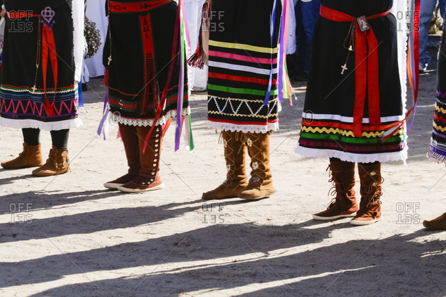 Tewa women dancers wearing moccasins in Tortugas Pueblo, New Mexico, USA