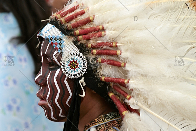 Ohkay Owingeh, New Mexico, USA: June 24, 2008: Native American child with a headdress