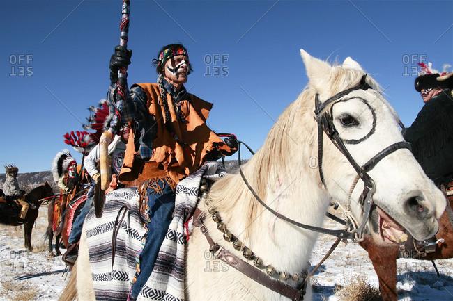 Alcalde, New Mexico, USA - December 27, 2008: American Indian men riding horses