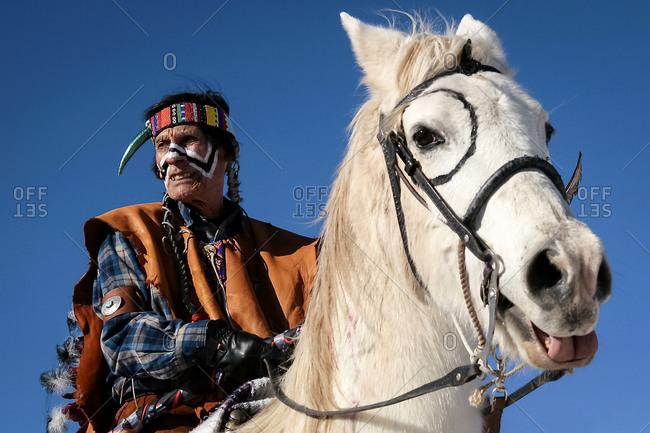 Alcalde, New Mexico, USA - December 27, 2008: American Indian man riding a horse