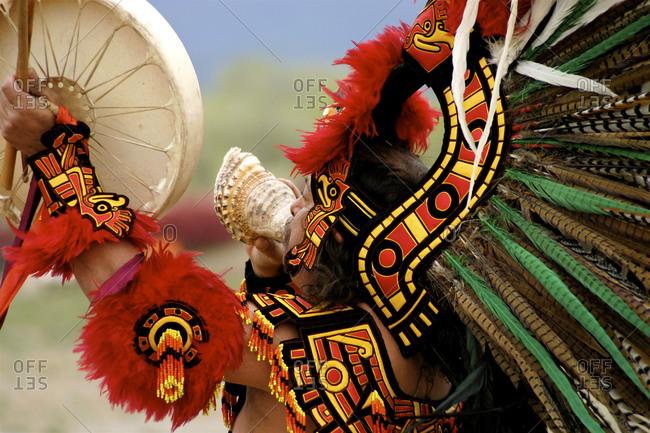 Santa Fe, New Mexico, USA - April 21, 2007: Aztec dancer blowing a caracol