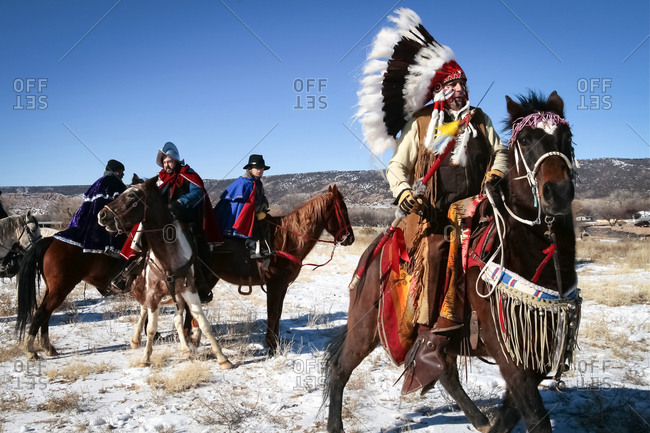 Alcalde, New Mexico, USA - December 27, 2008: American Indian men riding horses