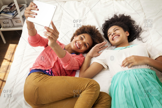 Smiling teenagers looking at a tablet