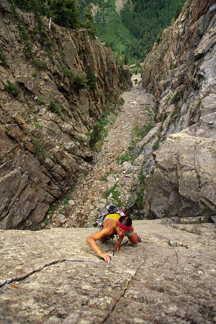 Woman rock climbing in a canyon Colorado