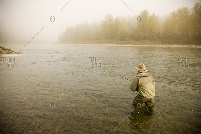 A man fly-fishing on Elk River BC Canada.