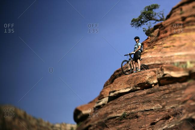 A woman mountain biking in the rocks in Sedona Arizona.